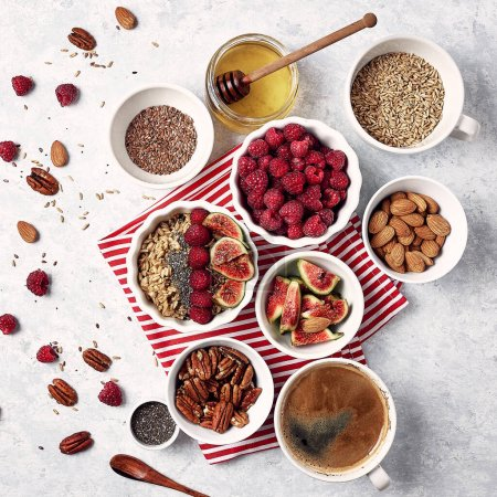 Photo for Healthy breakfast, top view. Oatmeal porridge with raspberries, figs, chia seeds, flax seeds, almonds and pecans, honey. - Royalty Free Image