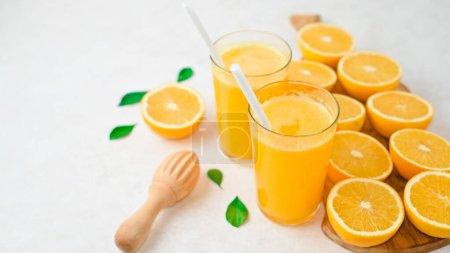 Photo for Freshly squeezed orange juice and slices of orange fruit isolated on white background - Royalty Free Image