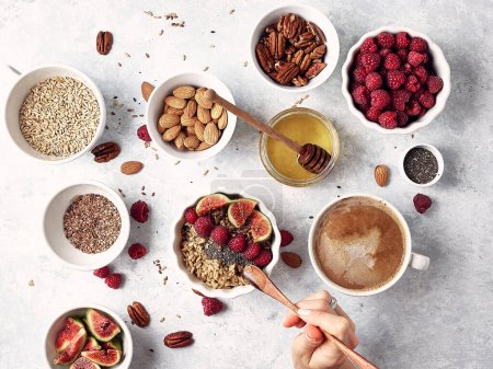 Photo for Healthy oatmeal breakfast with raspberries and finns, chia and flax seeds, pattern, top visas, good morning concept - Royalty Free Image
