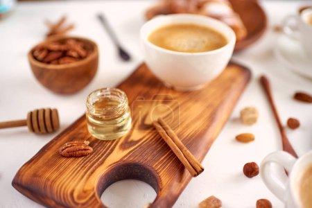 Photo for Breakfast pattern, coffee, honey, cinnamon sticks, nuts, sugar. Good morning concept. - Royalty Free Image