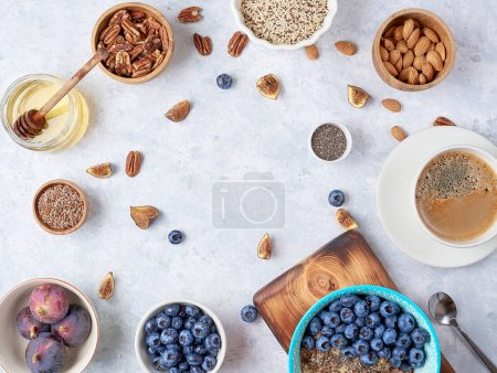 Photo for Healthy breakfast of superfoods, quinoa, honey, nuts figs coffee - Royalty Free Image