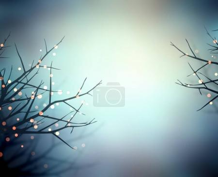 Sparkles on  branches in winter evening fog. Empty blurred blue hazy background. Golden lights in dark branches. Misty blue frosty background.