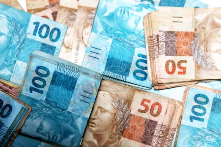 Photo for Cash money from Brazil with 50 and 100 reais notes - Royalty Free Image