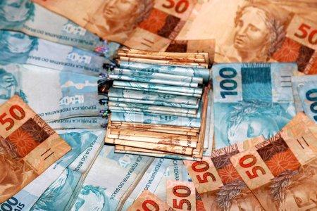 Photo for Pacotes de dinheiro com notas de 50 e 100 reais - Royalty Free Image
