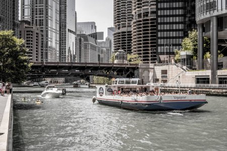 Chicago - July 2nd 2017: The Shoreline Sightseeing Voyageur boat filled with tourists floats by on the Chicago River in downtown on a busy summer day in July.
