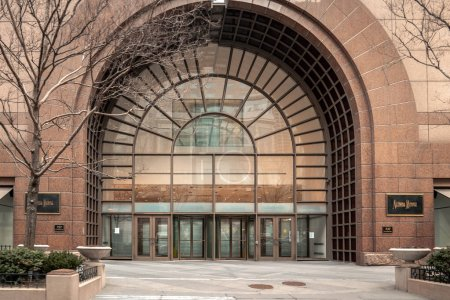 Chicago, IL - March 24th, 2020: Neiman Marcus departments store closes its doors and drops the security panels putting up signs at its entries amidst the COVID-19 or Coronavirus outbreak and pandemic.