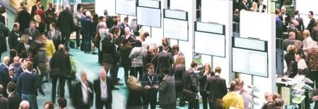 Photo for View of blurred crowd on a exhibition with trade fair booths. copyspace for your individual text. - Royalty Free Image