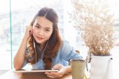 Asian woman listening music media entertainment on tablet, Relaxation concept