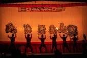 RATCHABURI, THAILAND - APRIL 18: Large Shadow Play is performed at Wat Khanon on April 18, 2015. The ancient performing art involves manipulating puppets of cowhide in front of a backlit white
