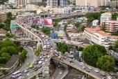 Bangkok - August 20, 2015: Traffic moves slowly along a busy highway on August 20, 2015 in Bangkok, Thailand. Annually an estimated 150,000 new cars join the already heavily congested streets of Bangkok.