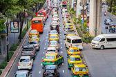 BANGKOK, THAILAND - NOVEMBER 8, 2015: Traffic moves slowly along a busy road in Bangkok, Thailand. Annually an estimated 150,000 new cars join the already heavily congested streets of Bangkok.