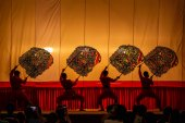 RATCHABURI, THAILAND - MARCH 20: Large Shadow Play is performed at Wat Khanon on March 20, 2016. The ancient performing art involves manipulating puppets of cowhide in front of a backlit white