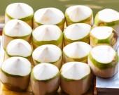 Fresh coconuts at Damnoen Saduak floating market in Ratchaburi near Bangkok, Thailand