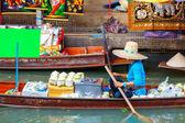 Fresh coconuts at Damnoen Saduak floating market in Ratchaburi near Bangkok, Thailand. selective focus