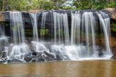 Tat Ton Waterfall, The beautiful waterfall in deep forest during raining season at Tat Ton National Park, Ubon Ratchathani province, Thailand.
