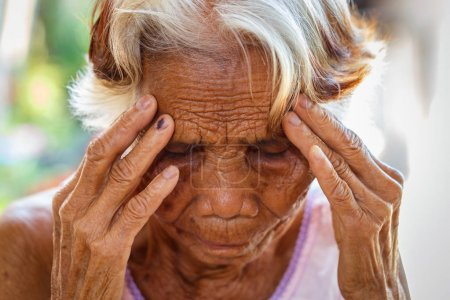 Photo for Age, Vision and old people concept - Close up of senior asian woman face and eye, Asian senior woman with sinusitis (sinusitis) - Royalty Free Image