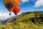 Aerial view from colorful hot air balloons flying over Inthanon Mountain at Kew Mae Pan Nature Trail, Chiang Mai Province, Thailand
