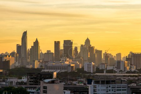 Photo for Aerial view modern office buildings in Bangkok city downtown with sunrise time, Bangkok Province, Thailand - Royalty Free Image
