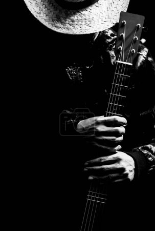 Photo for Musician holding guitar, black and white filter for music background - Royalty Free Image