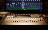 sound mixer fader, signal level on screen. music technology background