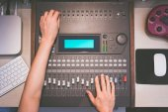 sound engineer hands working on digital sound mixer, music recording concept