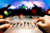 sound engineer hands working on sound mixer in live concert