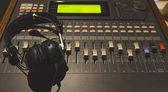 headphone on sound mixer, music background