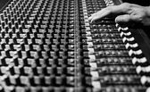 male sound engineer hands working on sound mixer for recording, broadcasting, music production background
