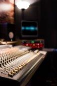 audio mixing console and studio equipment in recording, broadcasting, editing studio