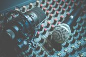 dynamic & condenser microphone on audio mixing console, recording concept
