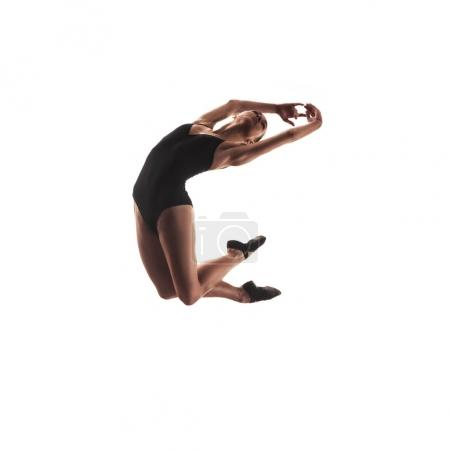 Ballerina in black outfit jumpimg