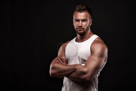 Portrait of athletic man in white undershirt