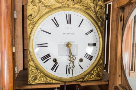 Clock Wall clock Clock and two candlesticks