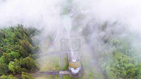 Thrilling view from above of a ski springboard covered in clouds