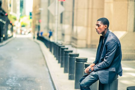 Young African American Man thinking outside on street in New Yor