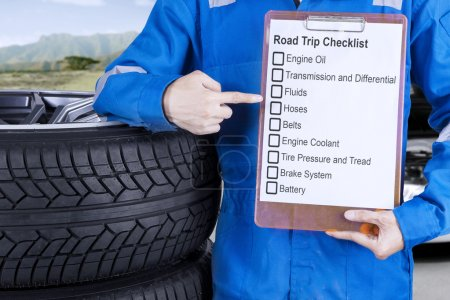 Mechanic giving road trip tips