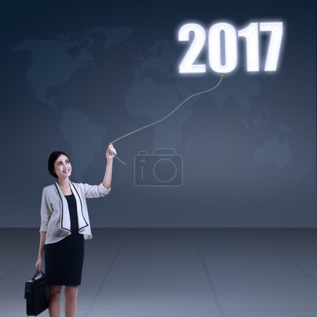 Businesswoman pulls number 2017