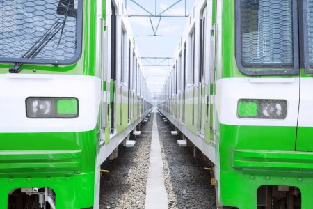 Two green electric trains