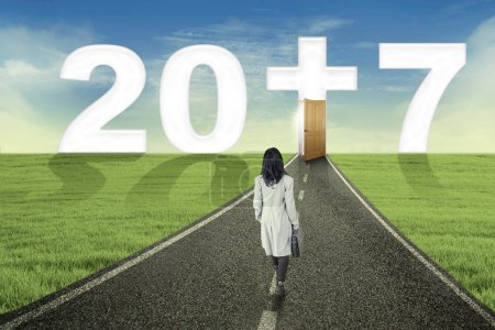 Entrepreneur walking on the road to number 2017