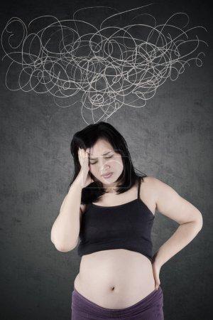 Pregnant mother feeling headache