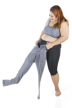 Overweight woman wearing old jeans