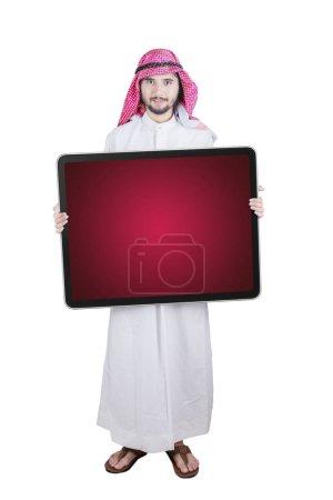 Arabian businessman holds empty board on studio