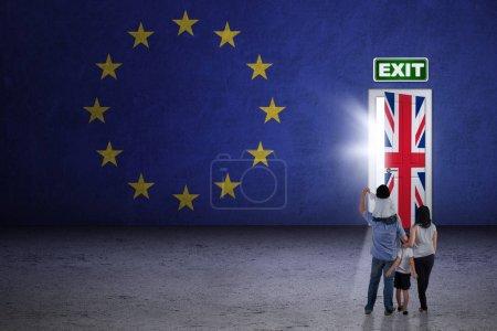 Family looking at brexit door
