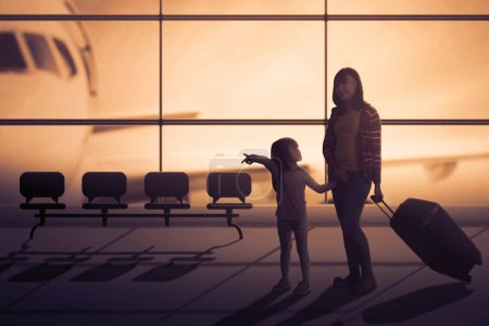 Mother and daughter with suitcase in airport hall
