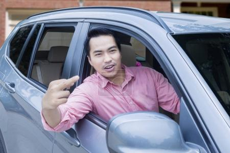Angry driver shows middle finger