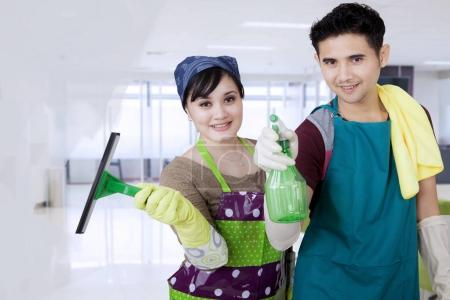 Photo for Corporate office cleaners working cleaning the window - Royalty Free Image