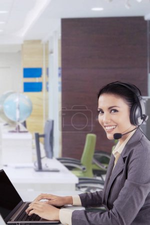Smiling customer service lady with headset