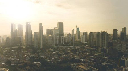 Photo for Aerial view of beautiful Jakarta city with skyscraper and residential house at sunset time - Royalty Free Image