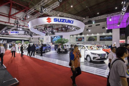 Photo for JAKARTA - Indonesia. May 02, 2018: Crowded people visiting Suzuki booth at the exhibition of Indonesia International Motor Show - Royalty Free Image