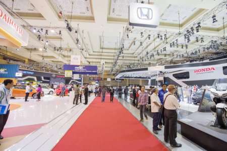Photo for JAKARTA - Indonesia. May 02, 2018: Crowded people visiting automotive exhibition at Indonesia International Motor Show 2018 - Royalty Free Image